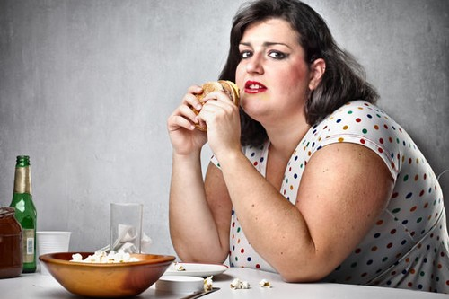 obese woman eating junk food